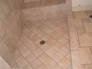 Shower floor repair large crack in shower tile from the for Cracked bathroom tile repair