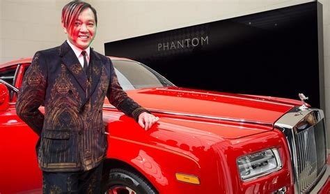 hotels  hung receives    highly bespoke  gaudy red rolls royce phantoms