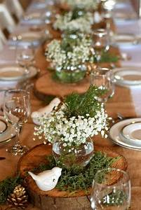 Picture Of a wood slice with greenery, baby's breath and