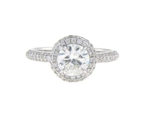 .96ct Round Brilliant Diamond In Pave Halo Mounting With