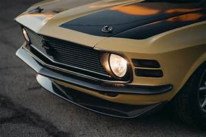 1970 Ford Mustang Boss 302 by SpeedKore and Robert Downey Jr front grille headlight on - Motortrend