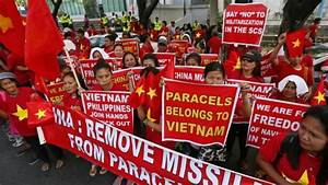 Philippine diplomat warns China over disputed shoal in ...