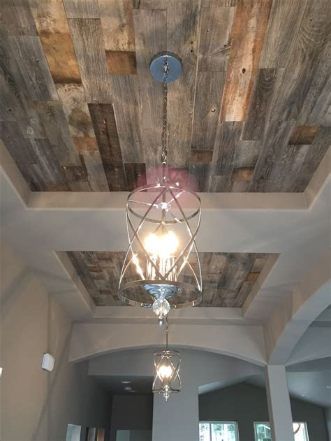 stunning accent feature double entry coffered ceilings  stikwood paneling