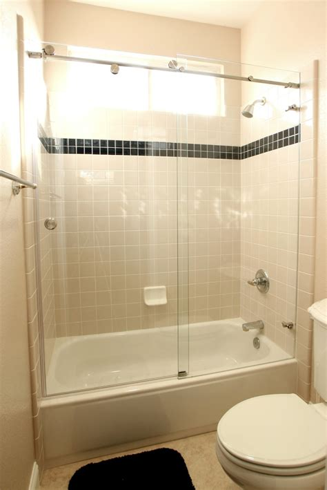 Sliding Glass Door Combined With White Tub Placed On The
