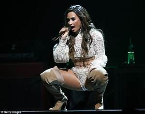 Demi Lovato takes to the stage in flesh-flashing fishnet ...