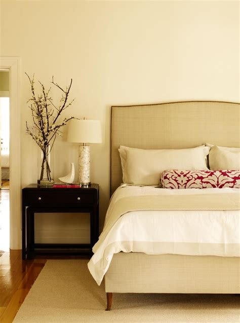 a crisp clean bedroom featuring olympic paint color