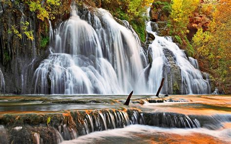 autumn waterfall cascade trees  yellow  red leaves