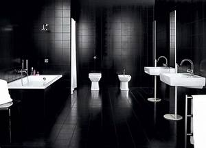 lovely-large-bathroom-with-dark-wall-tiles-white-sinks-and ...