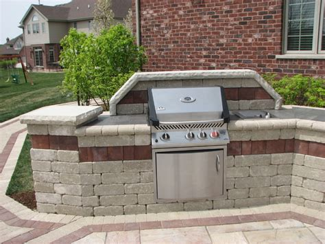 paver patio with built in grill and raised planters