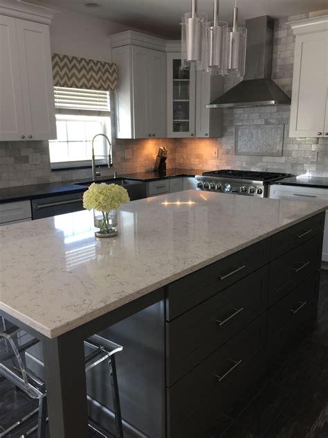 white arabesque quartz island kitchen remodel
