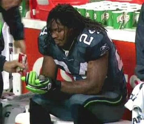 marshawn lynch scores beast mode touchdown eats skittles