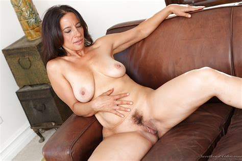 mature brunette melissa monet stripping and spreading her legs