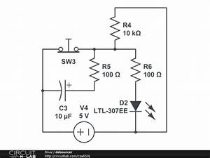how does the capacitor in a debouncing circuit work With how circuit work