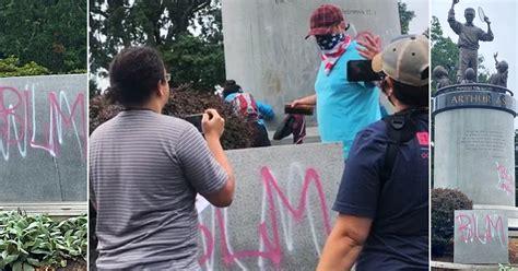 arthur ashe statue vandalized  white lives matter