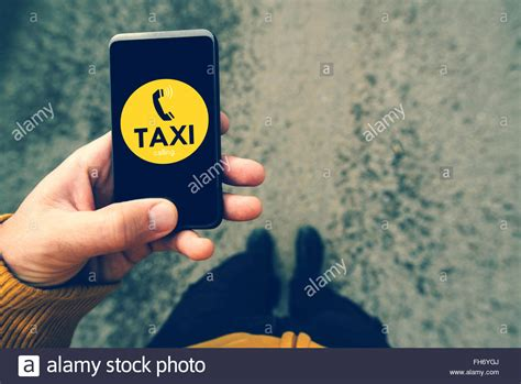 taxi phone number using smartphone mobile app to call taxi dialing cab