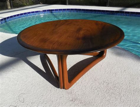 First, this design isn't necessarily my own. Mid Century Lane round coffee table 1963, MidCenturyFLA, https://www.etsy.com/listing/171135208 ...