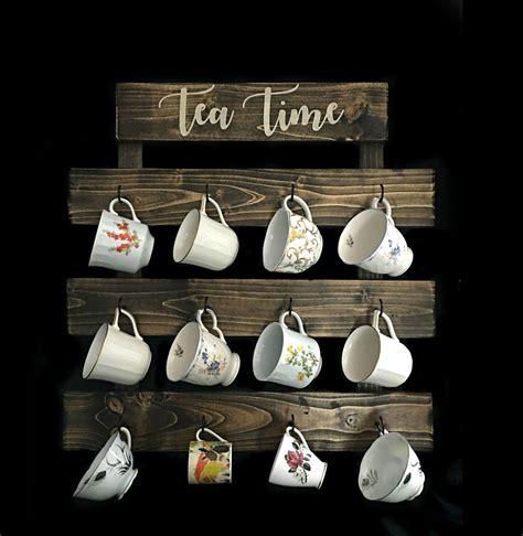 My husband & i handmake each and every one! Tea cup rack Farmhouse coffee mug wall rack Tea cup ...