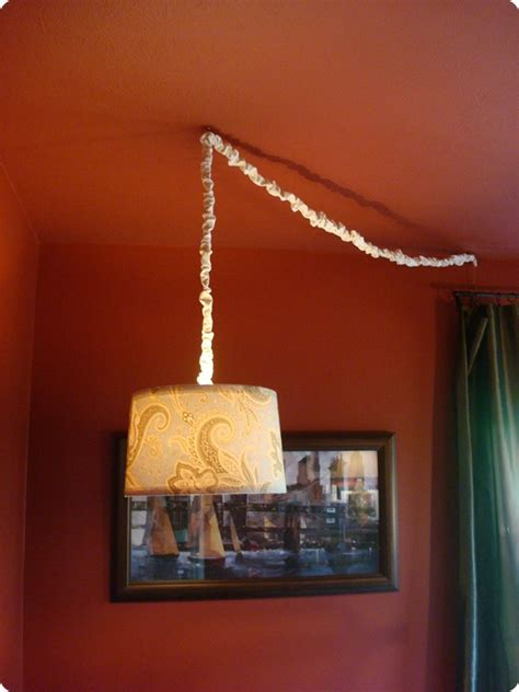 diy drum shade chandelier from thrifty decor