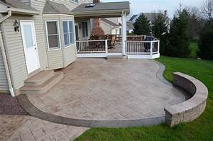 grey Stained Concrete Patio floor with grey stone bench