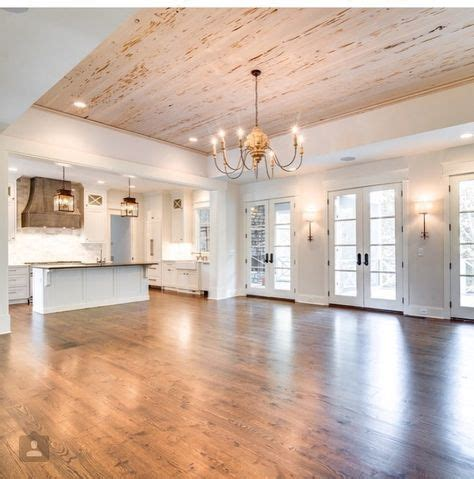 open concept living area  lots  natural light hardwood floors rustic wood ceiling white