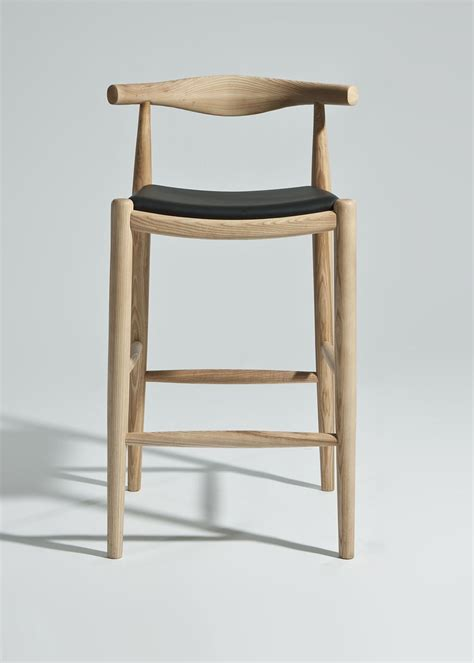 Wooden Island Stools by The Tusk Bar Stool Has A Solid Wood Frame With An