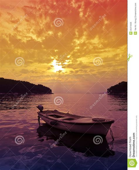 sunset scene  small boat stock photo image