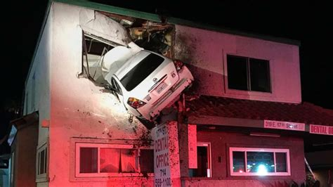 dramatic video captures car crashing   floor dental