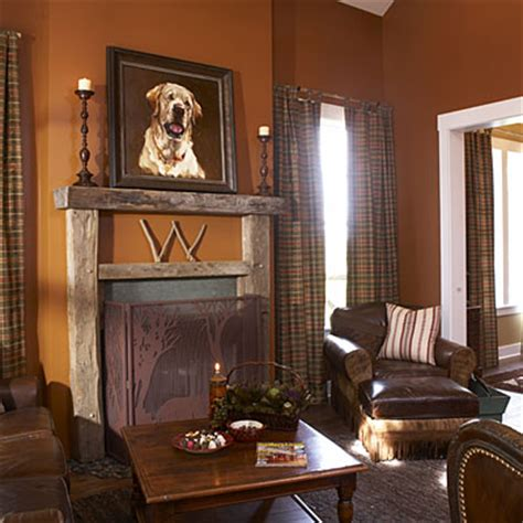 primitive living room wall colors get the lodge look by pairing rich leathers with rustic