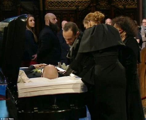 Celine Dion At Her Husband's Visitation...touches His Face