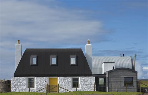 Modern Curved Roof House With Cottage-like Addition In