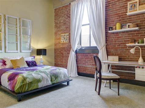 exposed brick wall  urban loft bedroom hgtv