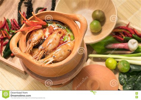 pot cuisine tom yum goong in a clay pot spicy soup traditional