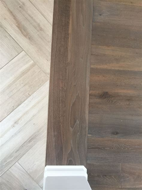 herringbone tile floor kitchen contemporary with accent floor transition laminate to herringbone tile pattern