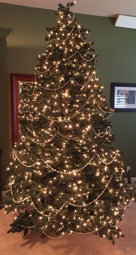 how to hang garland on christmas tree 19 steps to a perfectly decorated tree