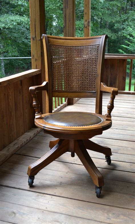 desk chair with wheels vintage wood oak office chair swivel wheels cane back vinyl