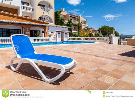 deck chair in a swimming pool stock photos image 33795343
