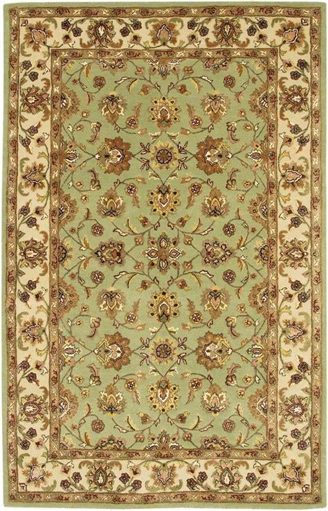 mint green oriental rug  browntan walls goldcream