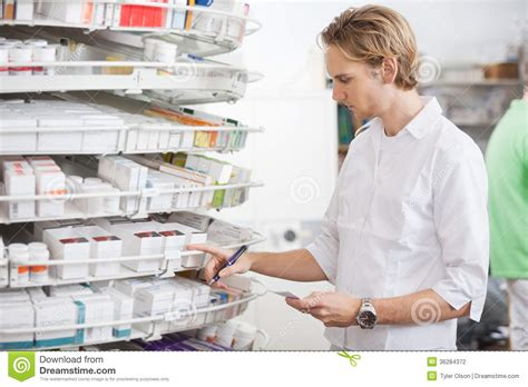 Prescription Pharmacy by Pharmacist Filling Prescription Stock Photography