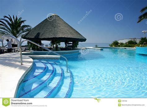 Tiki Hut And Bar By Swimming Pool Of Luxury Hotel Stock