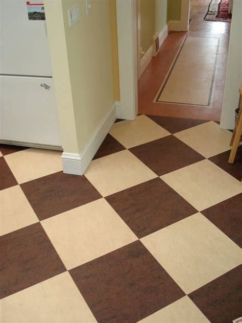 prefab flooring kitchen marmoleum modular tile in checkerboard design in brown and cream by mahoney floors