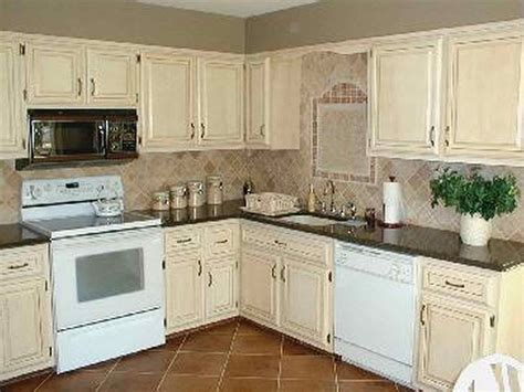 painted kitchen cabinets white how to paint your kitchen cabinets antique white 3990