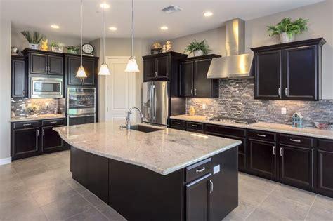 love  kitchen  dark cabinets light granite