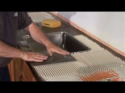 how to put tile on kitchen countertop schluter 174 countertop system installation segment 3 tiled 9536