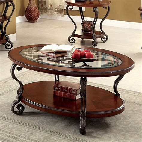 Features coffee table and two end tables with glass top (8mm beveled glass). May Brown Cherry Wood/Metal/Glass Coffee Table by Furniture of America