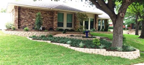 landscaping a sloped front yard sloped front yard after with multi level landscaping yelp