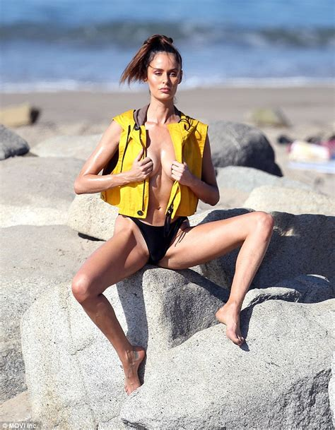 Nicole Trunfio Poses Topless In Just A Life Vest And Skimpy Bikini Bottoms As She Flashes