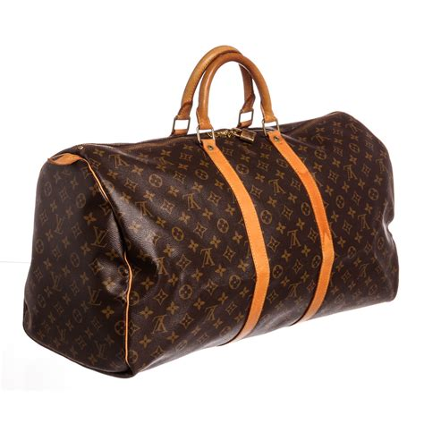 louis vuitton monogram keepall  duffle bag sp vintage louis vuitton touch  modern