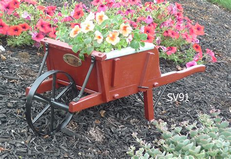 garden decor buckboard wagons wheelbarrows planters