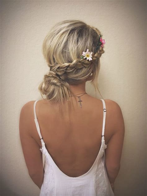 Messy Low Bun With Braids And Flowers Hair