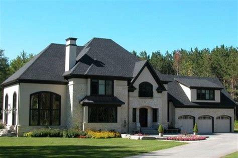 light brick possible limestone stucco eek roof
